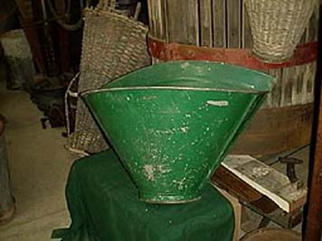 large photo of vintage metal grape harvest basket in green paint