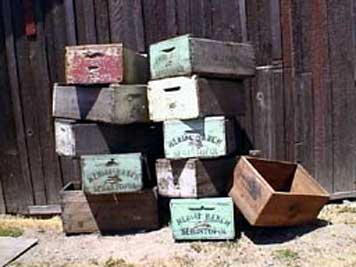 large photo of stack of vintage wooden grape crates